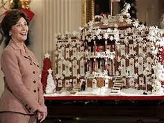 White House Christmas::Laura Bush in front of the annual White House Gingerbread house. A very 'Snowy' version.. . i  l.o.v.e it!