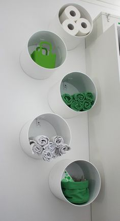 A friend of mine did this with thick cardboard shipping tubes cut into sections. Her goal was an entire wall of cubies.