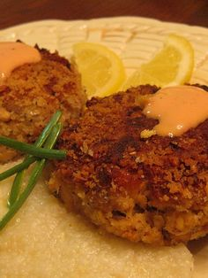 Salmon  Croquettes ·     2 Cans of Salmon, no bones, just meat.·        Half a cup of mayonnaise…good mayonnaise (Hellman's)·        ¾ teaspoon of onion powder…you can use green onion in place if  you wish or in addition.·        Salt and pepper to  taste…fresh cracked.·         1 cup of Panko…I  used the Italian but the plain work  1 large egg·        About ¾ cup of canola oil for frying