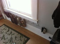 Shoes on hooks. Love this. Use command hooks so it doesn't damage the walls.