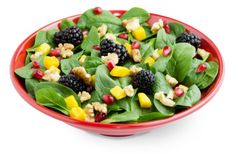 I had this salad at Zupas last night and it was so good!  Baby spinach, mango, blackberries, pomegranate, walnuts and a blueberry vinaigrette dressing.  Superfood Delight Salad