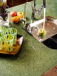 Recycled Material Countertops Turn trash into your treasured countertop. Recycled materials are becoming popular surfaces, thanks to a focus on environmentally friendly design. Here's a guide to some favorite green choices. Green Countertops, Recycled Glass Countertops, Cheap Countertops, Countertop Materials, Kitchen Countertops, Kitchen Paint, New Kitchen, Kitchen Design, Kitchen Ideas