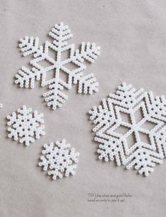 Nord 02 Melty (Hama) beads snow flake ornaments - add twine to hang!Melty (Hama) beads snow flake ornaments - add twine to hang! Hama Beads Design, Hama Beads Patterns, Beading Patterns, Peyote Patterns, Christmas Perler Beads, Natal Diy, Art Perle, 8bit Art, Peler Beads
