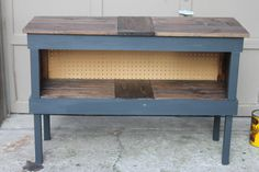 Grey slate shelf made from used shipping crates,