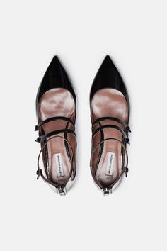 """When I started, shoes were all huge platforms,"" says designer Tabitha Simmons. ""There were lots of bells and whistles. I wanted to do something quieter."" Pointed-toe flats have long been at the core of Simmons's collection, and this especially elegant Mary Jane emphasizes its streamlined shape with gleaming patent leather, a trio of straps (with decorative buttons), and a sleek rear zipper closure. Finishing touches include a leather sole and padded insole for wear-all-day comfort."