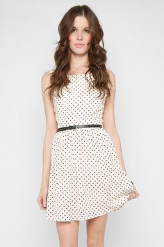 Love this too!! Cute polka dots and love the high neckline.