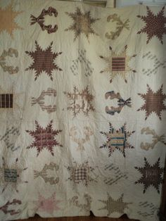 "Civil War Era Feathered Star Laurels Quilt Antique 100 Hand Stitched | eBay seller nibbyme, staring at 150.00, c. 1860, from Blue Ridge mountain area, entirely hand sewn, hand applied binding, combination of feathered stars and laurels, tiny 1"" triangles, blocks: 14"" square; quilted at 10 spi in cirle and leaf batters, front & back cream cotton, very thin cotton batting"