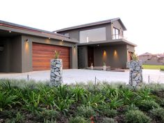 Earp Construction develops and sells properties in George on the Garden Route in South Africa. There are a range of design styles and sizes to suit your budget. Golf Estate, Open Living Area, Wooden Decks, Property For Sale, South Africa, Swimming Pools, Construction, Mansions, Lighting