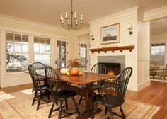 Cedar Bluff traditional dining room- wall color around window is BM Greenmount Silk and trim is Acadia White.