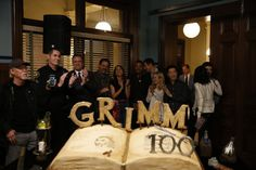 """Grimm"" celebrates the filming of its 100th episode on the set in Portland, with Governor Kate Brown, cast, and a cake-cutting ceremony."