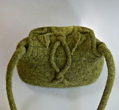 The Leaf and Vine Felted Purse is knit in the round, then felted in a washing machine. The decorative leaves and vine are knit and felted separately then sewn to the felted purse. Decorative Leaves, Felt Purse, Knit In The Round, Purse Patterns, Small Bags, Felting, Ravelry, Vines, Purses And Bags