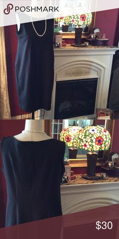 Simple elegant black dress Heavy Polyester Blend; like new; no snags,etc.  Perfect simple black dress for all occasions.  Dress up with pearls or scarf. Duet Designs Dresses Midi