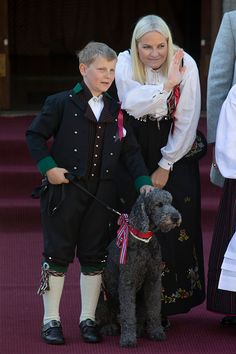 Crown Princess Mette-Marit of Norway, Prince Sverre Magnus of Norway, with the family pet dog Milly Kakao, attend the traditional morning children's parade, at their home, Skaugum, in Asker, near Oslo, on Norway's National Day, on May 17, 2016 in Oslo, Norway.