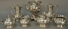 Nadeau's Auctions - Tiffany & Co. seven piece sterling silver tea and coffee set with hot water pot on stand, tea pot, coffee pots, hot milk jug, covered sugar bowl, and waste bowl marked Tiffany & Co. Union Square Design by Moore. 181.4 t oz. - Realized Price: $10,800.00