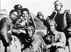 Lena Horne with a group of Tuskegee Airmen, January, 1945.  Ms. Horne refused to perform for segregated military audiences during World War II.