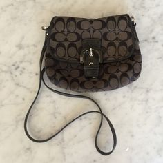 Coach Signature Black Crossbody Authentic Coach black crossbody bag! Shows some signs of wear as pictured and is reflected in price. Still has lots of life left! Very versatile and matches with everything. Can be dressed up or down - a perfect closet staple! Coach Bags Crossbody Bags