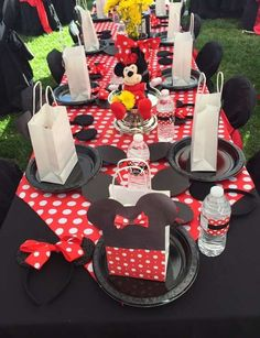 Red and black party table at a Minnie Mouse birthday party! See more party ideas at CatchMyParty.com!