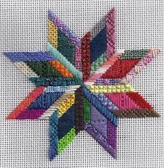 Patchwork star in needlepoint from Patt & Lee, stitched with threads from my scrap bag, every section uses a different thread.