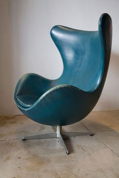 Vintage Arne Jacobsen Egg Chair In Original Bluish Leather Sideview-- http://www.novidecor.com/arne-jacobsen-egg-chair-multiple-colors-materials.html This website sells a bright baby-blue/robin's egg blue in leather for under $1000 (also lime green)