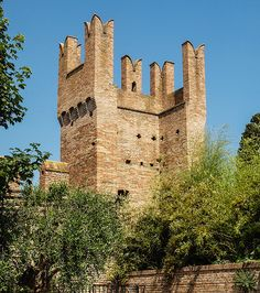 A tower on the ramparts of the fortified medieval  town of Gradara in Italy