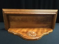 ETHAN ALLEN 43 2 92 WOOD SHELF WITH CARVED TRIM AND APPLIED ROSETTE. MEASURES 18 INCHES LONG AND 7 INCHES DEEP