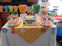 Cute monster party, favor-pails with eye stickers on them, car washer mitt decorated to look like monsters
