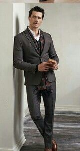 Nice shade of grey with a matching vest and a black, grey and red scarf.