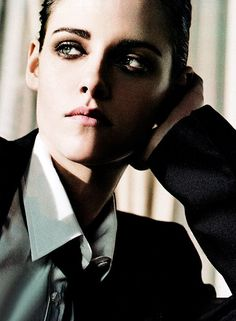 Kristen Stewart looking lovely and androgynous in this Elle Magazine spread.  The beautiful, shimmering eye makeup is perfection.