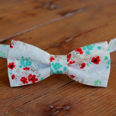 Boys Floral Bow Tie - Boys tan gray bow tie - cotton bow tie - red blue green brown gray - toddler bow tie - infant bowtie - ring bearer tie by becauseimme on Etsy https://www.etsy.com/listing/288075815/boys-floral-bow-tie-boys-tan-gray-bow
