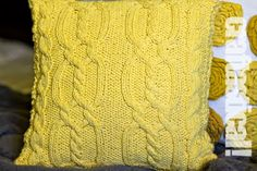 knitting pattern for this pillow cover--looks very snuggly, and it would probably be easier to practice cables for the first time on a pillow instead of a larger sweater. :-)
