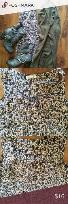 Sheer Blouse Sleeveless sheer blouse. Back has button down detail (see last 2 pics). Smoke free home. Can be worn dressed up or more casually.  Questions? PLEASE ASK! 👍 Mine Tops Blouses