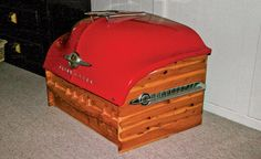 Steve Heller's red cedar chest is topped with a 1950 Oldsmobile hood. Heller drives the king of fins, a '?59 Caddy, which he has yet to turn into anything.