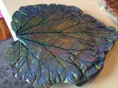 """Beautiful concrete cement leaf casting using a rhubarb leaf, custom painted """"peacock"""" with metallic acrylic paint by """"Crafting Night at Char's"""" Facebook Group!  https://www.facebook.com/groups/193598137479705/"""