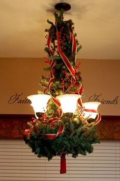 Christmas Chandelier. This is what you'll need: A plain wreath, a strand of garland, ribbon, and ornaments.