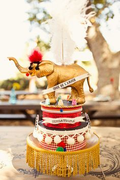 "circus ""cake"" centerpiece, photo by Jagger Photography http://ruffledblog.com/irvine-circus-wedding /search/?q=%23elephant&rs=hashtag /search/?q=%23weddingideas&rs=hashtag /search/?q=%23circuswedding&rs=hashtag"