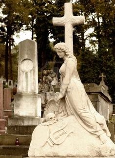 Tombstone women with a cross. Since its creation in 1787 Lychakiv Cemetery Lvov, Ukraine. Stock Photo - 9360047