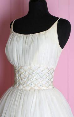 I love this dress! Go to the site, it's so pretty!  1950's White Tea Length Princess Wedding Dress