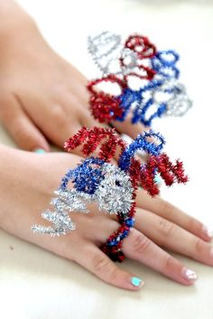 These bursting bands are made with six half pieces of sparkly red, white, and blue pipe cleaners. Use your fingers to spin the spirals into place. These firework rings are showstoppers.