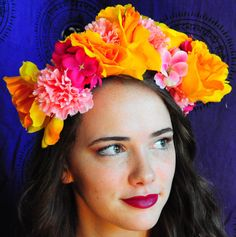 An adjustable, handmade floral headband/flower crown made by yours truly. This crown includes bright, eye-catching yellow and pink hues reminiscent of coral reefs and summer breezes. Wear it to your local art gallery, outdoor music festival, or capture fellow beach-goers on your way to the surf.