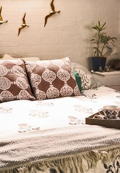 Neutral bedroom with block printed bedding