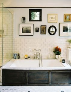 subway tile, white marble, dark stained wood, and a cute little window