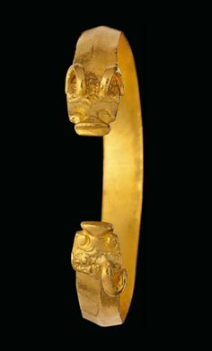 A GOLDEN HORDE GOLD BRACELET   NORTHERN BLACK SEA, CIRCA 13TH-15TH CENTURY A.D.   Of penannular form, the stylized animal-head terminals with curled horns and slit-like mouths  2½ in. (6.2 cm.) diam.