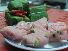 Usually served as a snack with raw garlic, Nem chua is eaten all year round as an appetizer or a side. It is eaten especially for the Lunar New Year by many Vietnamese families.