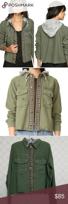 """NEW FREE PEOPLE Weekend Wanderer Military Jacket NEW Weekend Wanderer Military style jacket with frayed straight hem detail in moss green cotton; Button Front style with embroidered placket, collar and attached heather gray drawstring knit hood; Long sleeves with button cuffs and chest flap pockets; Unlined; 22"""" underarm to underarm 21"""" shoulder to hem Free People Jackets & Coats Utility Jackets"""
