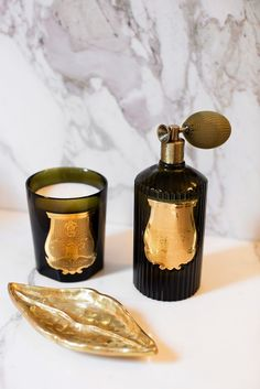 Kelly Wearstler's 8 Unexpected Details for Holiday Entertaining Gold Bathroom Accessories, Decorative Accessories, Natural Beauty Tips, Diy Beauty, Black Candles, Kelly Wearstler, Luxury Gifts, Scented Candles, Perfume Bottles