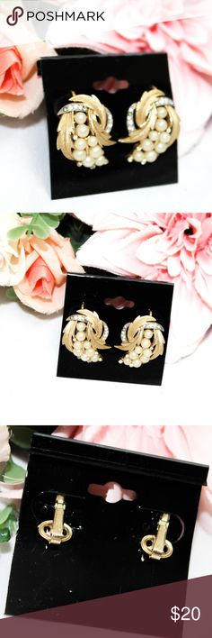 Trifari Vintage Gold Tone Clip-on Earrings Trifari Vintage Gold Tone Clip-on Earrings. Faux pearl accents. Gold tone earrings with cream colored accents. Good used condition. Minor signs of wear and age. Trifari Jewelry Earrings