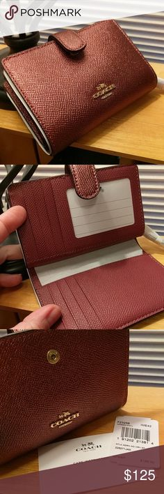 BNWT Coach Medium Corner Zip Wallet This little bifold wallet packs a wallop and a ton of stuff!  This is a coach NWT metallic cherry med corner zip wallet.  I swear it is nearly the same color as my favorite lipstick!  Retails for $165.  100% guaranteed authentic.  Will consider reasonable offers but no trades or deals off Posh.  TY Coach Bags Wallets