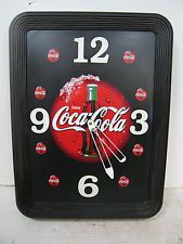 COCA COLA CLOCK, MANUFACTURED BY IMPACT INTERNATIONAL , NOT IN WORKING ORDER