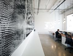 What can you do with 44,000 golf tees? You can make one gigantic, and most impressive, wall mosaic. It took Andrea Kordos and Joe Knight of blackLAB architects inc. four months and approximately 43,964 golf tees to make this wall magic happen in their very own office. Well, that, and a lot of hammering.