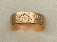 15th century, A gold posy ring engraved with a black letter inscription, '+ Mon Cuer Avez' (Have My Heart), on the outside of the hoop. The words of the inscription are separated by leafy sprig and flower motifs. The ring is complete, but slightly distorted.